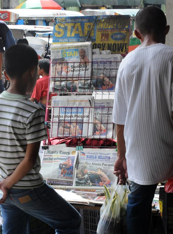 Pedestrians Read Newspapers AFP/Getty Images
