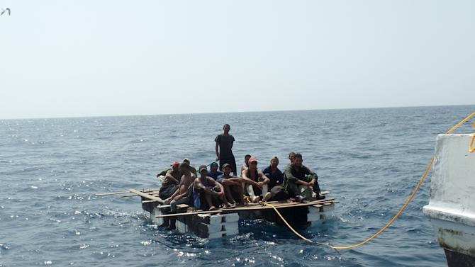 Cuban migrants are seen on a raft as they are rescued by members of Mexico's Navy (SEMAR) in Progreso, Yucatan