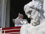Pope Benedict XVI blesses the faithful from his studio's window overlooking St.Peter's square during the Angelus noon prayer, at the Vatican, Sunday, Feb. 10, 2013. (AP Photo/Gregorio Borgia)