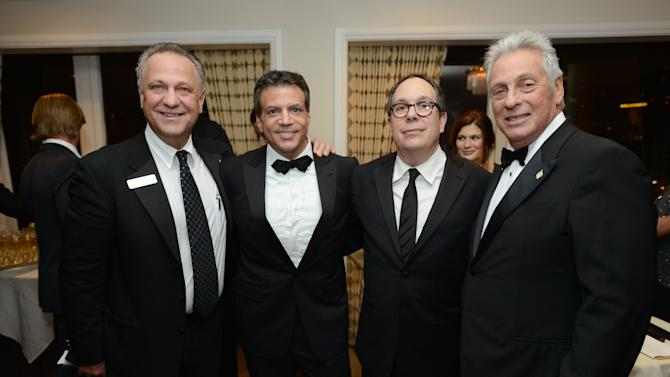 IMAGE DISTRIBUTED FOR THE PRODUCERS GUILD - From left, Vance Van Petten, Executive Director of the Producers Guild of America, Michael De Luca, Producers Guild Awards Chair, Mark Gordon, President of the Producers Guild of America, and Hawk Koch, Academy of Motion Picture Arts and Sciences President, pose at the 24th Annual Producers Guild (PGA) Awards at the Beverly Hilton Hotel on Saturday Jan. 26, 2013, in Beverly Hills, Calif. (Photo by Jordan Strauss/Invision for Producers Guild/AP Images)