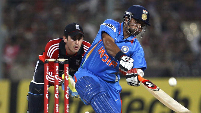 India's Suresh Raina, right, prepares to play a shot as England's wicketkeeper Craig Kieswetter reacts during their Twenty20 international cricket match in Kolkata, India, Saturday, Oct. 29, 2011. (AP Photo/Aijaz Rahi)