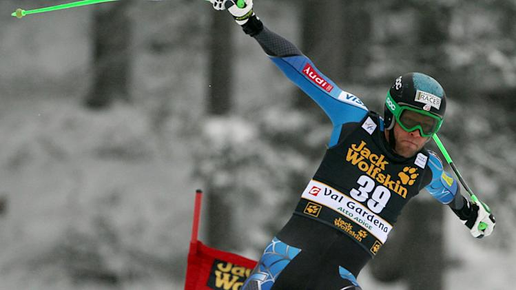 Steven Nyman, of the United States, is airborne as he competes on his way to win an alpine ski, men's World Cup downhill, in Val Gardena, Italy, Saturday, Dec. 15, 2012. (AP Photo/Alessandro Trovati)