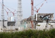 Nuclear reactor buildings in Okuma Town, Fukushima Prefecture on May 26. The head of Japanese utility Kansai Electric Power Company Monday urged the prime minister to quickly decide on restarting two nuclear reactors at its Oi plant to avoid summer power shortages