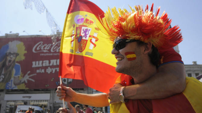 A Spain supporters cheers for his team ahead of the Euro 2012 soccer championship final match between  Spain and Italy in Kiev, Ukraine, Sunday, July 1, 2012. (AP Photo/Sergei Chuzavkov)