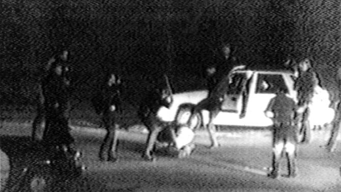 FILE - This March 3, 1991 image made from video provided by KTLA Los Angeles shows police officers beating a man, later identified as Rodney King. King, the black motorist whose 1991 videotaped beating by Los Angeles police officers was the touchstone for one of the most destructive race riots in the nation's history, has died, his publicist said Sunday, June 17, 2012. He was 47. (AP Photo/Courtesy of KTLA Los Angeles, George Holliday)