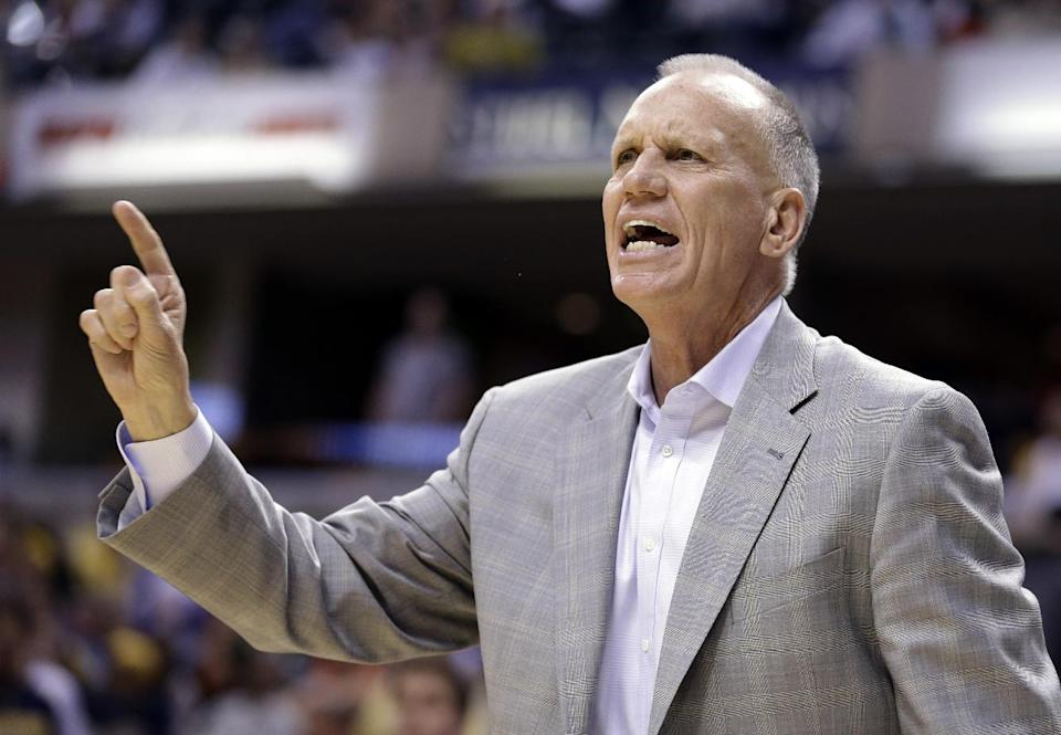 Philadelphia 76ers head coach Doug Collins calls a play for his team as they play the Indiana Pacers in the second half of an NBA basketball game in Indianapolis, Wednesday, April 17, 2013. The 76ers won 105-95. (AP Photo/Michael Conroy)