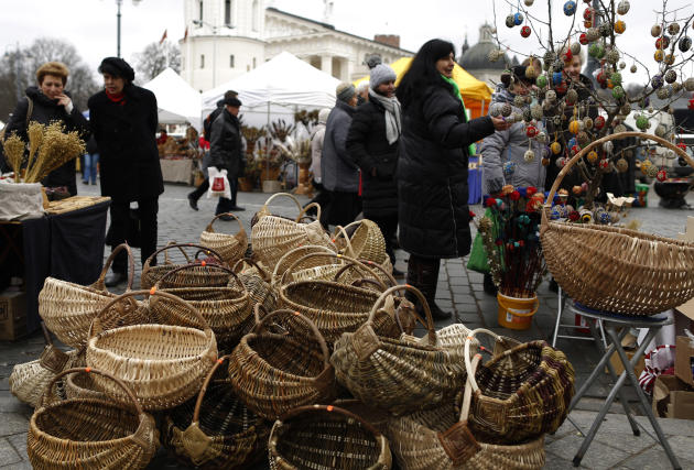 People browse the products on offer during the traditional Kaziukas fair, a large annual folk arts and craft fair in Vilnius, Lithuania, Friday, March 7, 2014. The festival honors St. Casimir, the pat