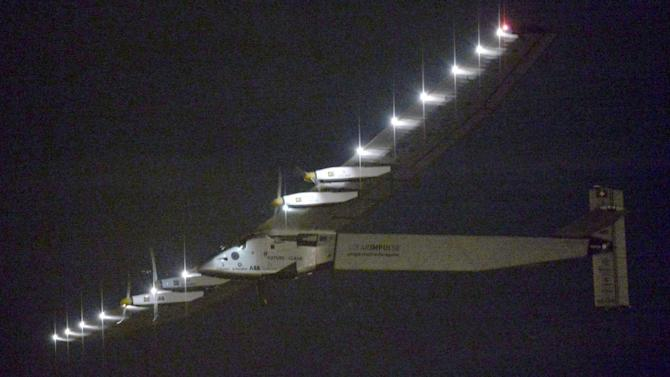 The Solar Impulse 2 flies over Nagoya Airport after taking off in Toyoyama, near Nagoya, central Japan, early Monday, June 29, 2015.  The solar-powered plane, with Swiss pilot Andre Borschberg at the controls,  departed from central Japan for Hawaii just before dawn on Monday local time. Solar Impulse was due to depart last week, but it was postponed due to weather conditions.(Kyodo News via AP) JAPAN OUT, MANDATORY CREDIT