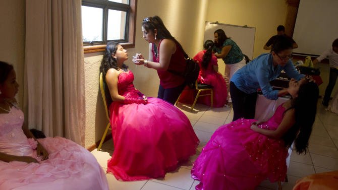 """Nicaraguan girls suffering from cancer prepare for a """"quinceanera"""" party in Managua, Nicaragua, Saturday Sept. 21, 2013. For each of the past five years, Nicaragua's Association of Mothers and Fathers of Children with Cancer and Leukemia has put on a """"quinceanera"""" party for girls from poor, rural families, teens who have the added burden of dealing with cancer. This year's party feted 37 girls between ages 14 and 16 on Saturday night at a hotel in Nicaragua's capital.(AP Photo/Esteban Felix)"""