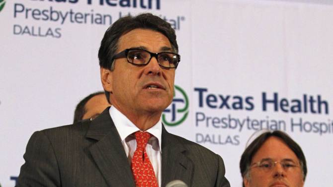 Texas Governor Perry speaks at a media conference at Texas Health Presbyterian Hospital