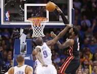 Miami Heat forward LeBron James (6) dunks in front of Oklahoma City Thunder forward Serge Ibaka (9) during the fourth quarter of an NBA basketball game in Oklahoma City, Thursday, Feb. 20, 2014. James fell to the floor with a bloody nose. Miami won 103-81. (AP Photo/Sue Ogrocki)