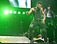 FILE - In this Feb. 2, 2011 file photo, Usher performs at the o2 arena in London. Usher, who had electronic-flavored successes with the will.i.am-produced OMG, DJ Got Us Fallin In Love Again and David Guettas Without You, says his new album will blend electronic and soul, and will feature Swedish House Mafia, Diplo, Klas Ahlund (the main producer behind Robyn), and Luke Steele of the Australian electronic duo Empire of the Sun. (AP Photo/Joel Ryan, file)