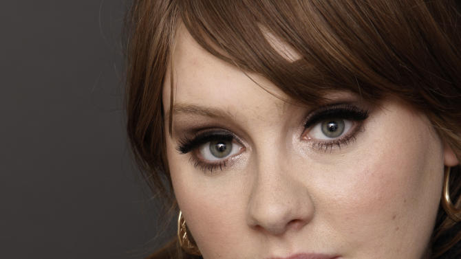 FILE - In this Nov. 19, 2008 file photo, British singer Adele poses for a portrait in Los Angeles. Adele was forced to cancel dates on her North American tour earlier this month because of laryngitis. But now, the British singer has rescheduled those dates, in addition to adding more shows in cities like Las Vegas and Miami. A statement released by Columbia Records Thursday, June 23, 2011, said the first batch of concerts will begin in Vancouver on Aug. 9; She will tour for the rest of the month, then resume performances on Oct. 7 in Atlantic City, N.J. (AP Photo/Matt Sayles, file)