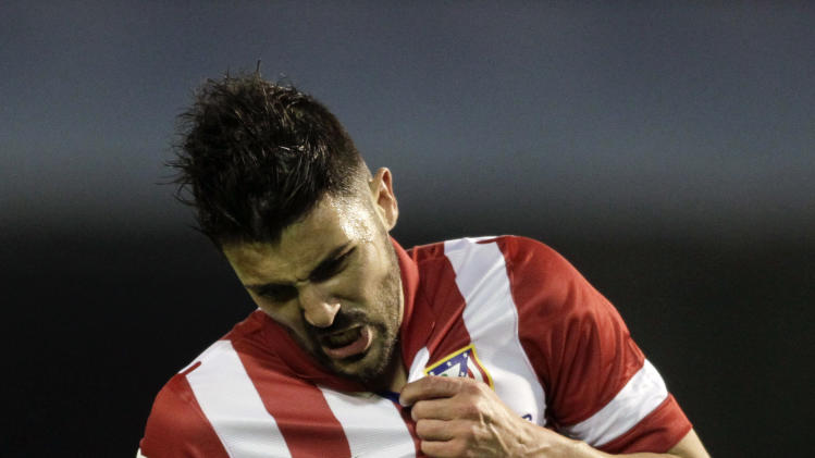 Atletico Madrid's Villa celebrates his goal against Celta Vigo during their Spanish first division match in Vigo