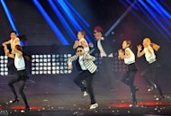 """Gangnam Style"" star Psy (C) performs his new single ""Gentleman"" at a concert in Seoul on April 13, 2013. The dance video to ""Gentleman"", the South Korean singer's long-awaited follow up to ""Gangnam Style, was only posted on YouTube at 9:00pm (1200 GMT) on Saturday"
