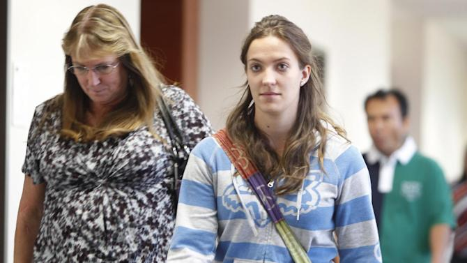 Family members and victims leave court after a hearing for suspected movie theater shooter James Holmes in district court in Centennial, Colo., on Thursday, Sept. 20, 2012.  Holmes has been charged in the shooting at the Aurora theater on July 20 that killed twelve people and injured more than 50. (AP Photo/Ed Andrieski)