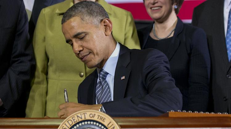 President Obama Signs Law 2014