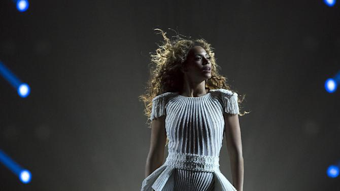"IMAGE DISTRIBUTED FOR PARKWOOD ENTERTAINMENT - Singer Beyonce performs on her ""Mrs. Carter Show World Tour 2013"" at the Ziggo Dome on Monday, April 22, 2013 in Amsterdam. Beyonce is wearing a custom hand beaded peplum one-piece by Ralph & Russo with shoes by Stuart Wieztman. (Photo by Yosra El-Essawy/Invision for Parkwood Entertainment/AP Images)"