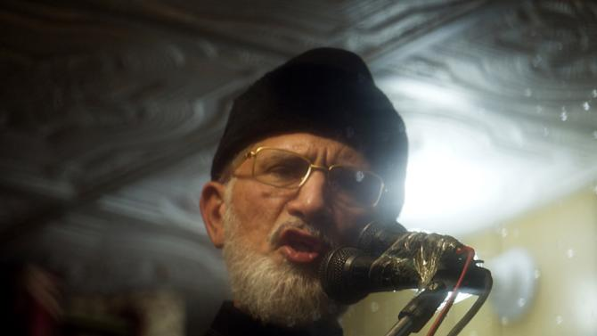 Pakistani Sunni cleric Tahir-ul-Qadri addresses a rally from his bullet-proof container in Islamabad, Pakistan, Thursday, Jan. 17, 2013. Qadri is demanding the government be dissolved and replaced with a caretaker administration formed in consultation with the judiciary and the military. He also wants electoral reform to weed out corrupt politicians and prevent them from winning elections in the future. (AP Photo/B.K. Bangash)