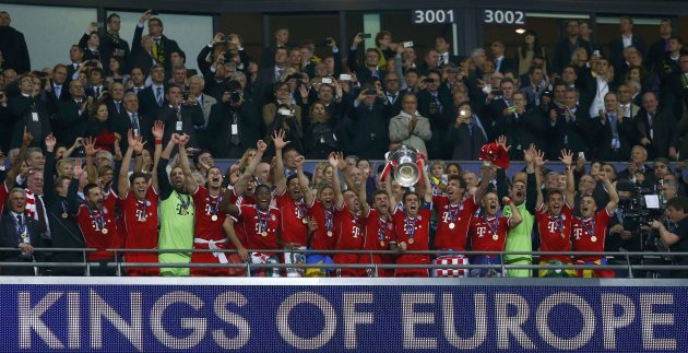 Bayern Munich players hold trophy as celebrate winning Champions League final soccer match against Borussia Dortmund in London