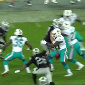 Miami Dolphins wide receiver Jarvis Landry fumbles