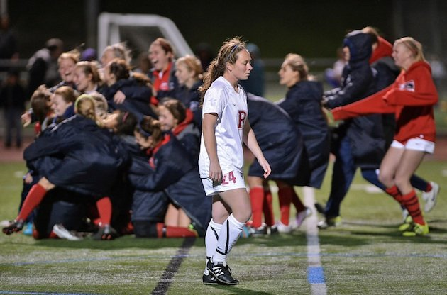 Redondo's Janel De Curtis walks toward her teammates after her penalty was saved in Redondo's shootout loss &#x2014; The Daily Breeze
