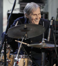 "FILE - In this Oct. 9, 2009 file photo, Levon Helm, right, performs with his band on the ""Imus in the Morning"" program on the Fox Business channel, in New York. The influential Grammy-winning singer and drummer for The Band died of throat cancer earlier this year at age 71. John Mayer, Gregg Allman, Dierks Bentley and several other musicians are getting together to pay tribute to the late Levon Helm. The ""Love for Levon"" benefit concert will be held Oct. 3 at the Izod Center in East Rutherford, N.J. (AP Photo/Richard Drew, File)"