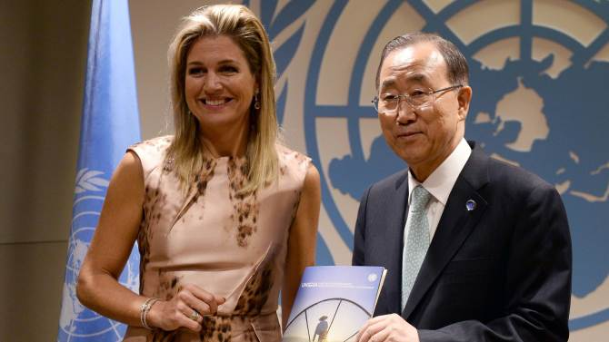 Netherlands' Queen Maxima hands a report to U.N. Secretary-General Ban before a meeting on the sideline of the U.N. General Assembly in New York