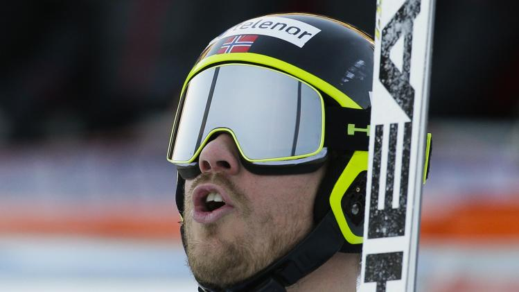 Jansrud of Norway reacts after crossing the finish line to place second in the men's World Cup Downhill skiing race in Val Gardena