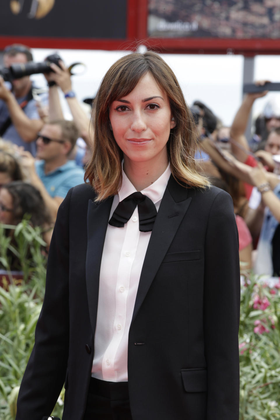 Director Gia Coppola poses for photographers as she arrives on the red carpet for the film Palo Alto at the 70th edition of the Venice Film Festival held from Aug. 28 through Sept. 7, in Venice, Italy, Sunday, Sept. 1, 2013. (AP Photo/Andrew Medichini)