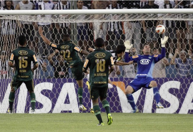 Velazquez of Paraguay's Libertad scores a goal against Brazil's Palmeiras during their Libertadores Cup soccer match in Asuncion