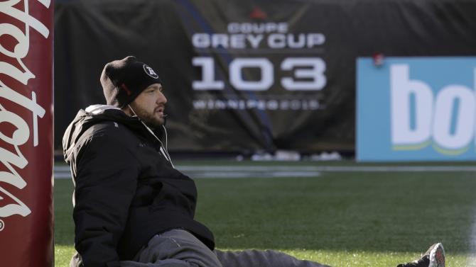 Ottawa Redblacks kicker Chris Milo stretches next to a goal post prior to pre-game activities before the CFL's 103rd Grey Cup championship football game against the Edmonton Eskimos in Winnipeg
