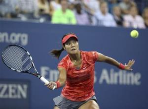 Li of China chases down a forehand to Jankovic of Serbia at the U.S. Open tennis championships in New York