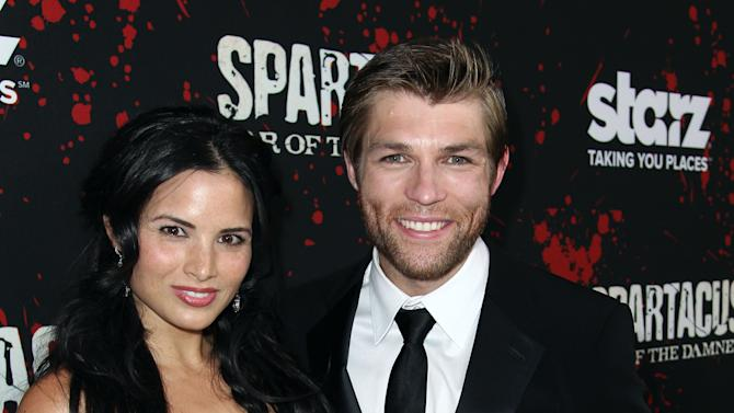 "IMAGE DISTRIBUTED FOR STARZ -Katrina Law, left, and Liam McIntyre pose together at the premiere of ""Spartacus: War of the Damned"" on Tuesday, Jan. 22, 2013 in Los Angeles. ""Spartacus: War of the Damned"" premieres Friday, Jan. 25 at 9PM on STARZ. (Photo by Matt Sayles/Invision for STARZ/AP Images)"