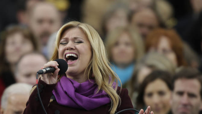 FILE- In this Jan. 21, 2013, file photo, singer Kelly Clarkson performs at the ceremonial swearing-in for President Barack Obama at the U.S. Capitol in Washington. The glitzy Mardi Gras Krewe of Endymion rolled its parade and super float through the Superdome on Saturday, Feb. 9, 2013, and Kelly Clarkson performed amid purple, green and gold lights in the first major event at the Superdome in New Orleans since the Super Bowl blackout. (AP Photo/Pablo Martinez Monsivais, File)