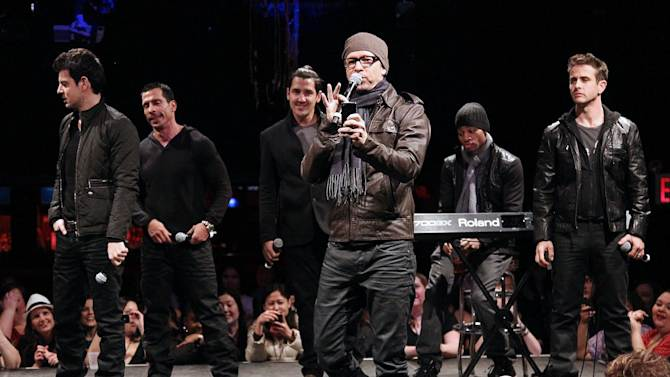 "In this picture provided by Starpix, New Kids on the Block members, from left, Jordan Knight, Danny Wood, Jonathan Knight, Donnie Wahlberg, and Joey McIntyre, far right, perform during the announcement of ""The Package Tour,"" Tuesday, Jan. 22, 2013 in New York. The major summer tour will feature New Kids on the Block, 98 Degrees and Boyz II Men. (AP Photo/Starpix, Kristina Bumphrey)"