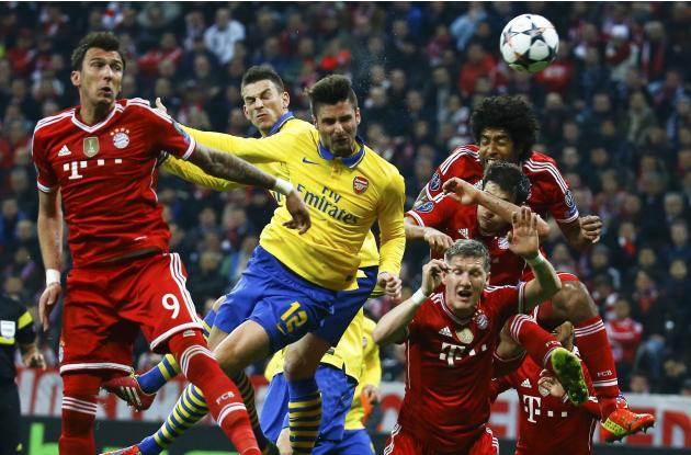 Bayern Munich's Mandzukic goes for a header with Arsenal's Giroud during their Champions League round of 16 second leg soccer match in Munich