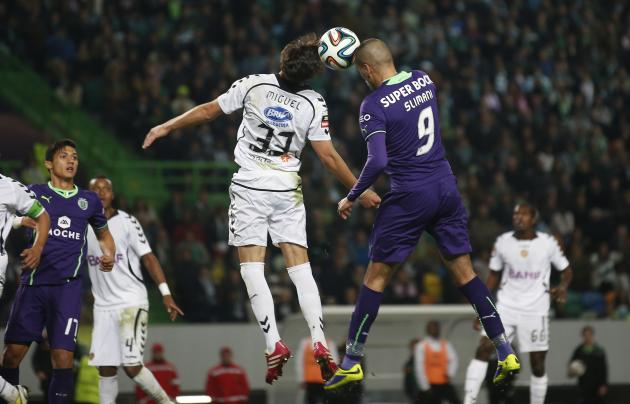 Sporting's Slimani heads for the ball with Nacional's Rodrigues during their Portuguese Premier League match in Lisbon