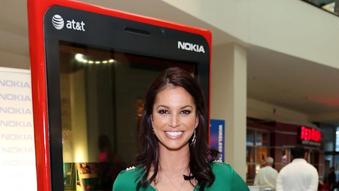IMAGE DISTRIBUTED FOR NOKIA - Melissa Rycroft introduces the NOKIA Lumia 920 smartphone to fans at the Northridge Fashion Center on Thurs., Dec. 20, 2012, in Los Angeles. (Photo by Casey Rodgers/Invision for Nokia/AP Images)