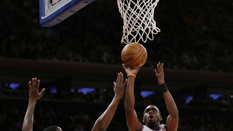 New York Knicks' Tim Hardaway Jr. (5) shoots over Philadelphia 76ers' Henry Sims (35) during the first half of an NBA basketball game Monday, March 10, 2014, in New York. (AP Photo/Frank Franklin II)