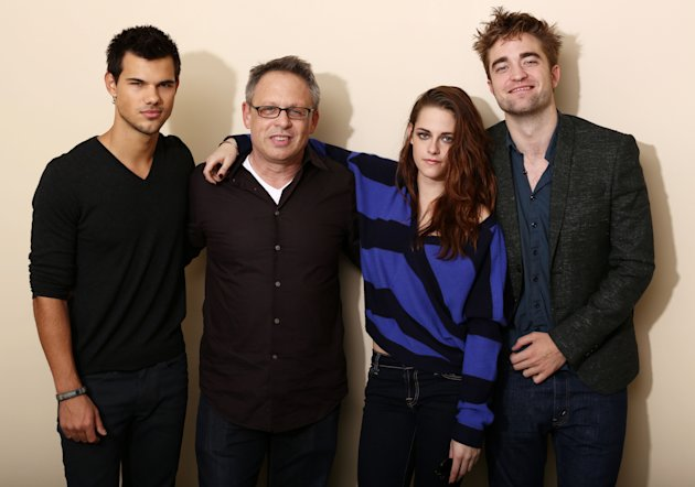 "In this Thursday, Nov. 1, 2012 photo, from left, actor Taylor Lautner, director Bill Condon, actress Kristen Stewart, and actor Robert Pattinson, from the upcoming film ""The Twilight Saga: Breaking Da"