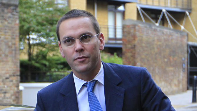 FILE - In this July 19, 2011 file photo, Chief executive of News Corporation Europe and Asia, James Murdoch, arrives at the News International headquarters in London. (AP Photo/Sang Tan, file)