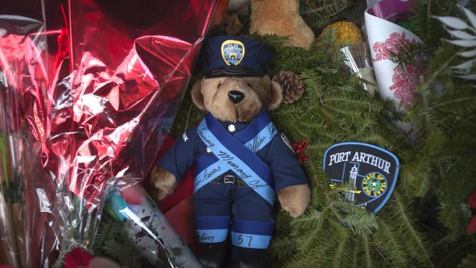 A teddy bear is pictured at a makeshift memorial in the Brooklyn borough of New York