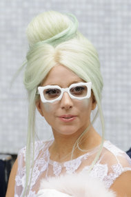 U.S. singer Lady Gaga arrives ahead of filming for a chat show at a central London venue, Wednesday, Oct. 5, 2011. (AP Photo/Jonathan Short)