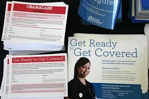 Information cards are stacked on a table during an Affordable Care Act outreach event for the Latino community in Los Angeles, California
