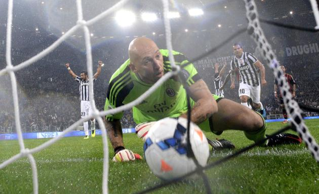 AC Milan's goalkeeper Abbiati fails to save a free kick shot by Juventus' Pirlo during their Italian Serie A match in Turin