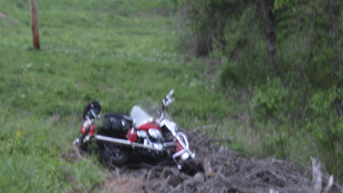 In this photo taken Sunday, April 1, 2012 and provided by the Arkansas State Police, the wreckage of Arkansas NCAA football coach Bobby Petrino's motorcycle rest off the shoulder of a highway near Crosses, Ark. The accident on Sunday injured Petrino and it was later disclosed that he was riding with a female employee. He has been put on leave after admitting he failed to disclose Jessica Dorrell's presence on the ride, and that the two had an inappropriate relationship. (AP Photo/Arkansas State Police)