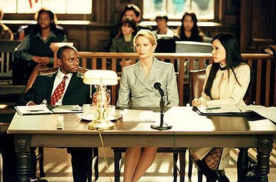 "Jackson (Taye Diggs, L) and Ling (Lucy Liu, R) represent a woman (guest star Kelly Lynch, C) sued for firing all the men at her company on the ""Boy's Town"" episode of Ally McBeal Ally McBeal"
