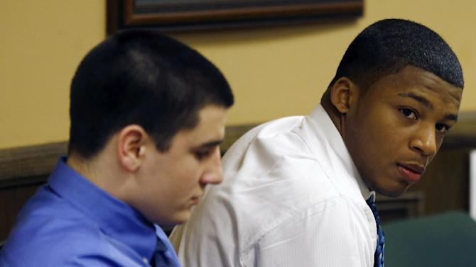 Trent Mays, 17, left, and co-defendant 16-year-old Ma'lik Richmond sit in court before the start of the third day of their trial on rape charges in juvenile court on Friday, March 15, 2013 in Steubenville, Ohio. Mays and Richmond are accused of raping a 16-year-old West Virginia girl in August of 2012. (AP Photo/Keith Srakocic, Pool)