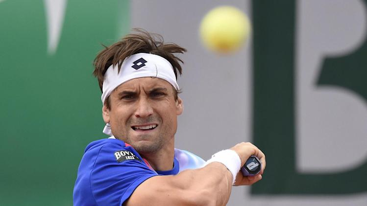 Spain's David Ferrer hits a return to Spain's Rafael Nadal during their French tennis Open quarter final match at the Roland Garros stadium in Paris on June 4, 2014